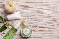 Flat lay composition with cosmetic products. On wooden background royalty free stock photos