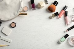 Flat lay composition with cosmetics, bottles of nail polish and space for text stock photos