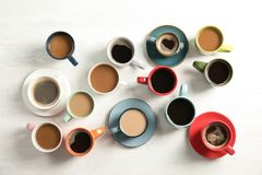 Flat lay composition with cups of coffee on light background. Food photography royalty free stock images