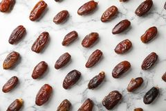 Flat lay composition with dates on marble background. Dried fruit as healthy snack stock photos