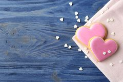 Flat lay composition with decorated heart shaped cookies and space for text stock photos