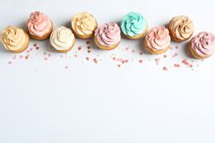 Flat lay composition with delicious birthday cupcakes. And space for text on white background royalty free stock photography