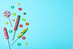 Flat lay composition with different candies and space for text stock photography