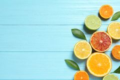 Flat lay composition with different citrus fruits on wooden background. Flat lay composition with different citrus fruits and space for text on wooden background royalty free stock images