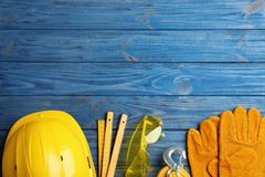 Flat lay composition with different construction tools and space for text on wooden background. Flat lay composition with different construction tools and space stock photos