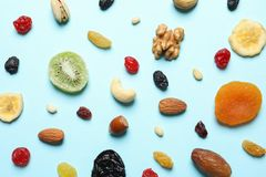 Flat lay composition of different dried fruits and nuts. On color background stock image