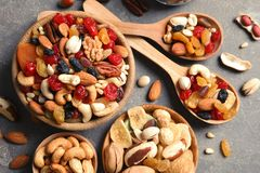 Flat lay composition of different dried fruits and nuts. On color background royalty free stock photo