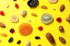 Flat lay composition of different dried fruits and nuts. On color background royalty free stock images