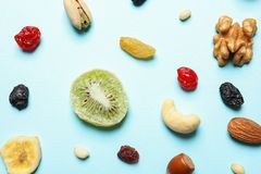 Flat lay composition of different dried fruits and nuts. On color background stock images