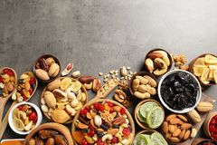 Flat lay composition of different dried fruits and nuts on color background. Space for text stock photos