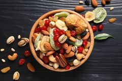 Flat lay composition of different dried fruits and nuts. On color wooden background stock images