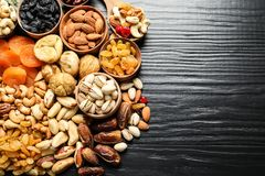 Flat lay composition of different dried fruits and nuts. On color wooden background. Space for text stock image