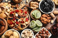 Flat lay composition of different dried fruits and nuts. On table royalty free stock photo