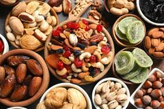 Flat lay composition of different dried fruits and nuts. On table stock photography