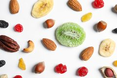 Flat lay composition of different dried fruits and nuts on white. Background stock photo