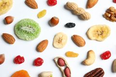 Flat lay composition of different dried fruits and nuts. On white background stock image