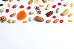 Flat lay composition of different dried fruits and nuts on white background. Space for text stock photo
