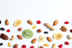 Flat lay composition of different dried fruits and nuts on white. Space for text. Flat lay composition of different dried fruits and nuts on white background stock image
