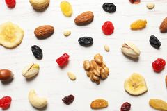 Flat lay composition of different dried fruits and nuts. On wooden background stock images