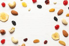 Flat lay composition of different dried fruits and nuts. On wooden background. Space for text royalty free stock photos