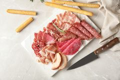 Flat lay composition with different meat delicacies. On gray background stock photo