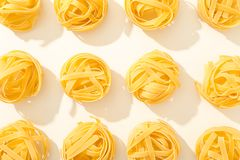 Flat lay composition with different pasta on white background stock photo