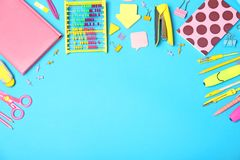 Flat lay composition with different school stationery color background. Flat lay composition with different school stationery on color background royalty free stock image