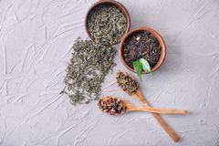 Flat lay composition with different types of dry tea leaves on light background royalty free stock image