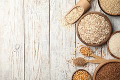Flat lay composition with different types of grains and cereals. On wooden background royalty free stock photography