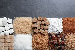 Flat lay composition with different types of sugar