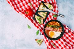 Flat lay composition with English breakfast. And avocado toast. Top view Royalty Free Stock Photography