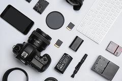Flat lay composition with equipment. For professional photographer on white background royalty free stock image