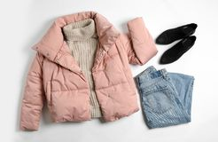 Flat lay composition with female winter clothes on white. Background royalty free stock photo