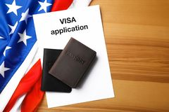 Flat lay composition with flag of USA, passports and visa application. On wooden background stock images