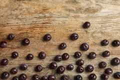 Flat lay composition with fresh acai berrie. S on wooden background stock photo