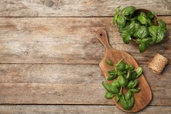 Flat lay composition with fresh basil. On wooden background. Space for text stock photos