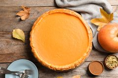 Flat lay composition with fresh delicious homemade pumpkin pie. On wooden background royalty free stock photos
