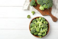 Composition with fresh green broccoli on wooden background, top view. Flat lay composition with fresh green broccoli on wooden background Stock Photos