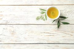 Flat lay composition with fresh olive oil. On wooden background stock photo
