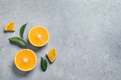 Flat lay composition with fresh oranges on grey. Space for text. Flat lay composition with fresh oranges on grey background. Space for text royalty free stock photo
