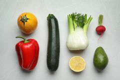 Flat lay composition with fresh ripe vegetables and fruits. On light background stock image
