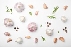 Flat lay composition with garlic. On light background royalty free stock image