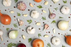 Flat lay composition with garlic and onion. On table stock image