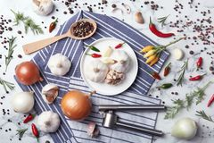 Flat lay composition with garlic, peppers and onions. On marble table stock photo