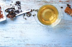 Flat lay composition with glass cup of hot tea on wooden background royalty free stock image