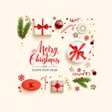 Flat lay composition. Green fir tree branches on light holiday background. Natural design elements. Festive background with gift boxes and Merry Christmas Royalty Free Stock Photo