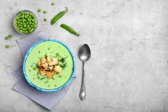 Flat lay composition with green pea soup. On grey background stock photos