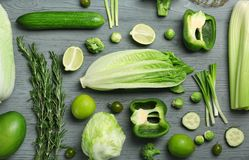 Flat lay composition with green vegetables. And fruits on wooden background. Food photography royalty free stock images