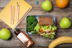 Flat lay composition with healthy food for school child. On wooden background royalty free stock image