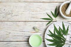 Flat lay composition with hemp leaves, seeds royalty free stock image